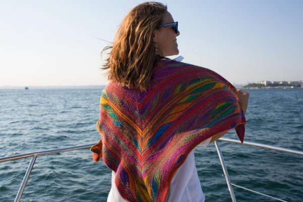 Woman wearing Papillon Shawl on boat