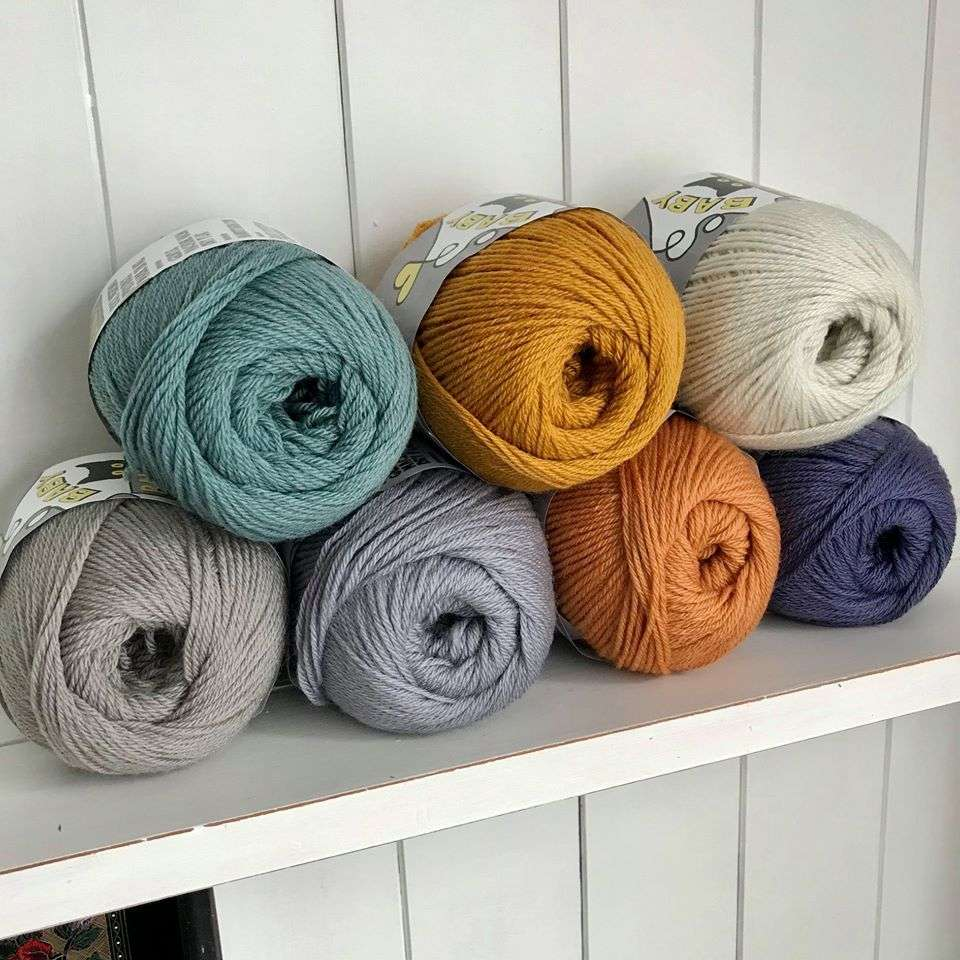 Baby Bandit merino yarn in 7 of the 11 colors we have