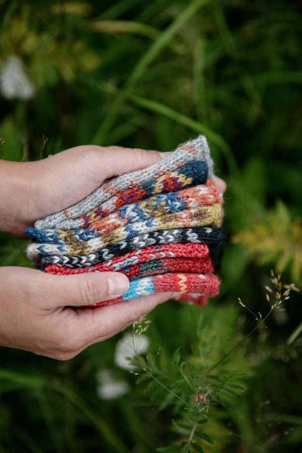 Stack of different coloured fair isle mitts