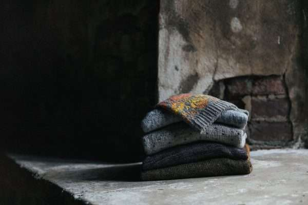 Stack of beautiful knitted colourwork garments