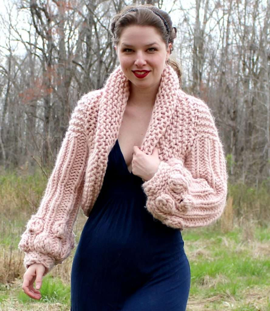 Balloon sleeve Sophia Cardigan by Kristin Jones. Sweater is pink.