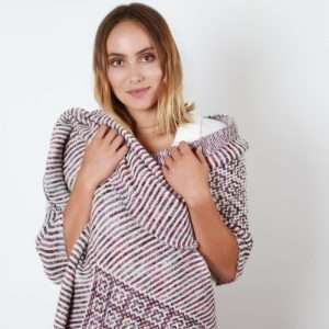 White woman wearing shawl made from Malabrigo Mechita
