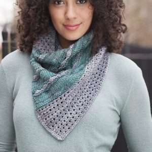 Woman wearing a scarf made from Malabrigo Rios yarn
